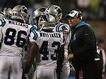 Carolina Panthers head coach Ron Rivera, right, gathers huddles his offensive unit in the NFC Western Division Playoffs against the Seattle Seahawks at CenturyLink Field  on January 10, 2015 in Seattle, Washington. The Seahawks beat the Panthers 31-17. ©2015. Jim Bryant Photo. All Rights Reserved.
