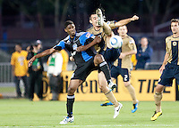 Andrew Jacobson (right) kicks the ball against Khari Stephenson (left). The San Jose Earthquakes defeated the Philadelphia Unioin 1-0 at Buck Shaw Stadium in Santa Clara, California on September 15th, 2010.