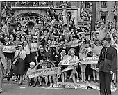 Paris, France - August 26, 1944 -- French civilians line the streets with shouts, signs, and smiles to welcome General Charles De Gaulle to liberated Paris, France on August 26, 1944..Credit: U.S. Army via CNP