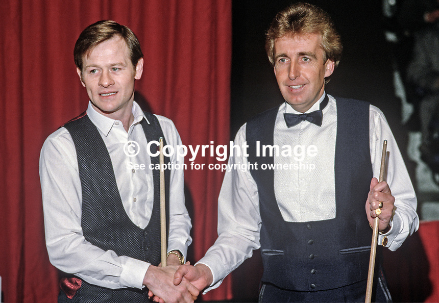 Alex Higgins, Belfast, N Ireland, professional snooker player, left, with Terry Griffiths, Wales, at the start of their match in the Irish Masters at Goffs, Rep of Ireland, 198503000034g..Copyright Image from Victor Patterson, 54 Dorchester Park, Belfast, UK, BT9 6RJ..Tel: +44 28 9066 1296.Mob: +44 7802 353836.Voicemail +44 20 8816 7153.Skype: victorpattersonbelfast.Email: victorpatterson@mac.com.Email: victorpatterson@ireland.com (back-up)..IMPORTANT: If you wish to use this image or any other of my images please go to www.victorpatterson.com and click on the Terms & Conditions. Then contact me by email or phone with the reference number(s) of the image(s) concerned.