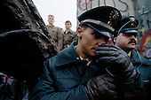 West Berlin, West Germany<br /> November 11, 1989<br /> <br /> German guards restrain people from climbing to the other side of the wall as a section is pulled down by west. The East German government lifts travel and emigration restrictions to the West on November 9, 1989.