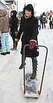 Young Woman Holding Kicksled in Kolkja Kelk, Tartu County, Estonia