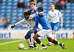 Rangers v St Johnstone....27.02.11 .Collin Samuel holds off Sasa Papac and Maurice Edu.Picture by Graeme Hart..Copyright Perthshire Picture Agency.Tel: 01738 623350  Mobile: 07990 594431