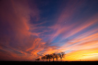 Extremely colorful sky at sunset on a winter day prior to a new weather system moving into the North Texas area. Scene photographed in a rural area near the city of Palmer, Texas.