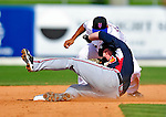 2 March 2010: Atlanta Braves catcher Clint Sammons slides safely into second ahead of the tag by Ruben Tejada of the New York Mets during the Opening Day of Grapefruit League play at Tradition Field in Port St. Lucie, Florida. The Mets defeated the Braves 4-2 in Spring Training action. Mandatory Credit: Ed Wolfstein Photo