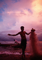 May 26th 2004-Com, East Timor- The sky over Com is aflame with a mystical light during sunset, as fisherman tend to their nets.  Photograph by Daniel J. Groshong/Tayo Photo Group
