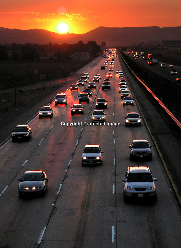 Eastbound traffic on interstate highway 580 near Pleasanton, Ca away from the setting sun. (2006 photo by Ron Riesterer)