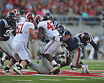 Alabama running back Eddie Lacy (42) is tackled by Ole Miss' Frank Crawford (5) at Vaught-Hemingway Stadium in Oxford, Miss. on Saturday, October 14, 2011. Alabama won 52-7.