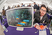 """Carlos Bautista explains his method of detecting landlines to better protect soldiers and civilians using augmented reality built on edge-based tracking at the NYU-Polytechnic School of Engineering's Research Expo in Brooklyn's """"Tech Triangle"""" in New York on Friday, April 24, 2015. Over forty research projects and their creators will exhibit and explain their research including cutting-edge robotics, engineering and biotechnology.  (© Richard B. Levine)"""