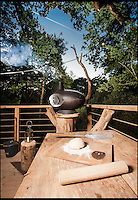 BNPS.co.uk (01202 558833)<br /> Pic: Mallinson/BNPS<br /> <br /> Pizza oven in the treetops...<br /> <br /> Release your inner Tarzan...in Britain's poshest treehouse.<br /> <br /> A luxury glamping site in deepest Dorset has created a luxurious treehouse that comes with its own sauna, hot tub, rotating fireplace and pizza oven.<br /> <br /> The Woodsman's Treehouse is perched 30ft from the ground on long stilts and has two floors. <br /> <br /> It has a spiral staircase and a stainless steel slide for quick access to the ground and can be rented out from &pound;390 a night. <br /> <br /> It is located at the Crafty Camping glamping site at Holditch in west Dorset.