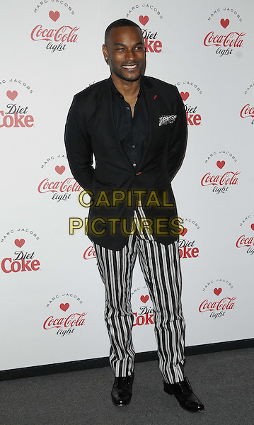 Tyson Beckford.The Diet Coke & Marc Jacobs Official Partnership launch party, German Gymnasium, London, England..March 11th, 2013.full length black jacket stripe suit white trousers  .CAP/CAN.©Can Nguyen/Capital Pictures.