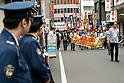 Labor activists group AEQUITAS marches in Tokyo