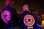 Freeport, New York, USA. 10th Sept. 2014. Blue Star Mothers of America members look at the shimmering night lights from houses along the canal while sailing on board the boat Miss Freeport V, which set sail from the Woodcleft Canal of the Freeport Nautical Mile after a dockside remembrance ceremony in honor of victims of the terrorist attacks of September 11 2001, on the eve of the 13th anniversary of the 9/11 attacks. On the back of each jacket is NY6, for the Long Island Blue Star Moms Chapter. Non-political Blue Star Mothers of America gives support for mothers with sons or daughters who are, or were, actively serving in the war.