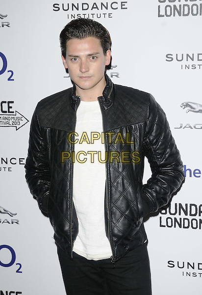 """Aneurin Barnard.attended the """"Emanuel & The Truth About Fishes"""" UK film premiere, the Sundance London 2013 film & music festival day 2, Cineworld cinemas, The O2, Peninsula Square, London, England, UK, .26th April 2013..half length black leather jacket quilted hands in pockets white top t-shirt .CAP/CAN.©Can Nguyen/Capital Pictures."""