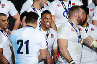 Anthony Watson of England is all smiles on the winners' podium. RBS Six Nations match between France and England on March 19, 2016 at the Stade de France in Paris, France. Photo by: Patrick Khachfe / Onside Images