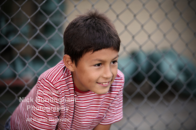 Young boy in front of fence - EXCLUSIVELY AVAILABLE HERE