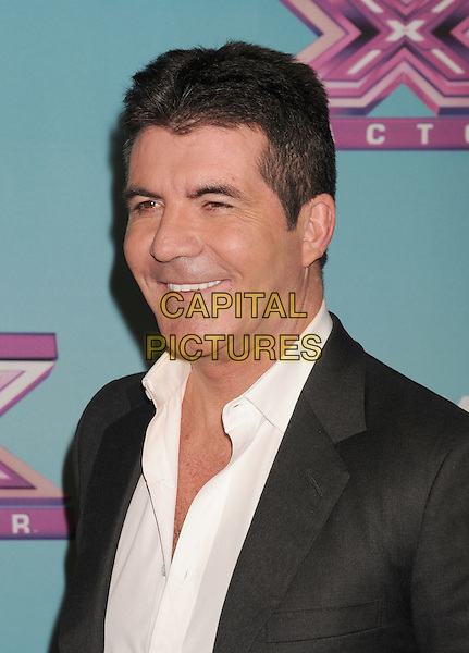 Simon Cowell.arriving at Fox's 'The X Factor' Season Finale Night 1 at CBS Televison City in Los Angeles, California, USA, .December 19th, 2012.  .portrait headshot  grey gray suit jacket white shirt smiling side profile .CAP/ROT/TM.©Tony Michaels/Roth Stock/Capital Pictures