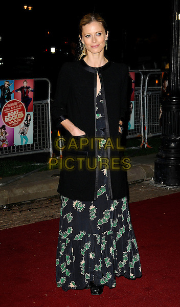 "LAURA BAILEY.""The Boat That Rocked"" world film premiere at The Odeon, Leicester Square, London, England..March 23rd, 2009.full length black coat jacket hands in pockets long maxi dress print blue green patterned printed silk satin trim.CAP/CAN.©Can Nguyen/Capital Pictures."