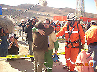 © Adam Patterson / Panos Pictures..Family photographs show the moments when Edison Pena returned to the surface..Edison Pena was the 12th miner to be freed from the San Jose mine in Chile where 33 miners were trapped for 69 days. He was the first to return home from hospital.