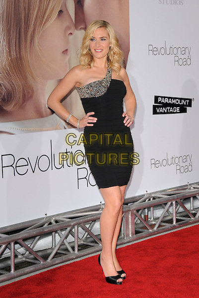 "KATE WINSLET.World Premiere of ""Revolutionary Road"" held at The Mann Village Theatre in Westwood, California, USA. .December 15th, 2008 .full length dress black jewel encrusted one shoulder open toe christian louboutin shoes heels hands on hips.CAP/DVS.©Debbie VanStory/Capital Pictures."