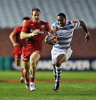 James Short races for the try-line. J.P. Morgan Premiership Rugby 7s match, between London Irish and Saracens on July 13, 2012 at the Twickenham Stoop in London, England. Photo by: Patrick Khachfe / Onside Images