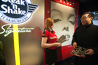 """Hundreds of burger lovers descend on the new Steak 'n Shake Signature restaurant in New York on its grand opening day, Thursday, January 12, 2012. The popular midwest chain opened its first New York outpost with a new concept for the restaurant, a smaller footprint and counter-only service, hence their """"Signature"""" branding. Founded in 1934 the company has nearly 500 restaurants with this one in New York being next to the Ed Sullivan Theatre where the Late Show with David Letterman Show is taped. © Richard B. Levine)"""