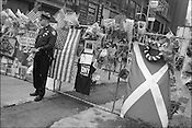 A New York policeman stands on Broadway beside flowers and cards of condolences to the victims of the September 11th 2001 terrorist attack on the World Trade Centre buildings in Lower Manhattan by AL-Qaeda terrorists. New York, America.