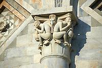 Grotesque Medieval pillar capital sculpture on the exterior of the Duomo Pisa