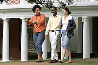 Second year UVa student Jade Craig, middle,  walks with 4th year student Kat Shea, right, and  4th year student Amey Adkins, left, on the lawn area of the University of Virginia in Charlottesville, Va. Photo/Andrew Shurtleff