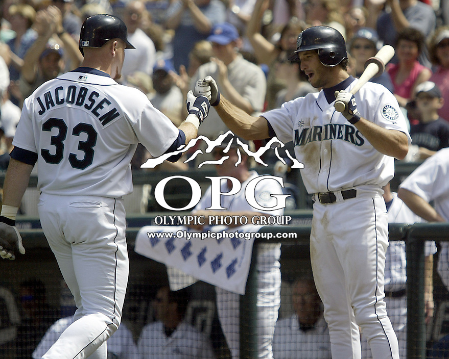 Seattle Mariners third baseman Justin Leone high fives ...