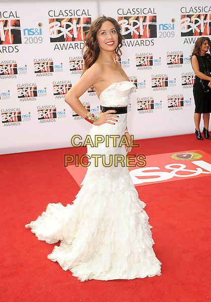 MYLEENE KLASS .attending The Classical Brit Awards 2009, Royal Albert Hall, London, England, UK, 14th May 2009.brits full length strapless white dress hand on hip long gown maxi train tiered ruffles layered black waistband bustier .CAP/BEL.©Tom Belcher/Capital Pictures