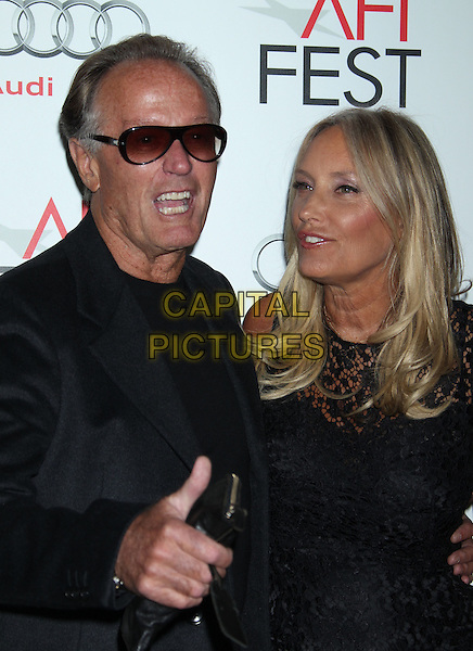 Peter Fonda, Margaret DeVogelaere.'Hitchcock' premiere during AFI Fest 2012 presented by Audi at Grauman's Chinese Theatre, Hollywood, California, USA..1st November 2012.half length jacket grey gray dress lace black top sunglasses shades married husband wife  mouth open hand thumb up.CAP/ADM/RE.©Russ Elliot/AdMedia/Capital Pictures.