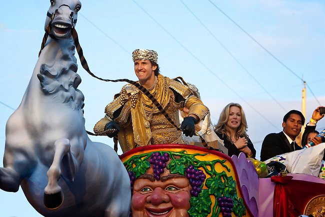 Super Bowl MVP and New Orleans Saints Quarterback Drew Brees #9 takes the reins as he reigns as King of Bacchus in the Krewe of Bacchus parade as they get ready to roll at Tchoupitoulas Street and Napoleon Avenue in New Orleans, Louisiana. USA.