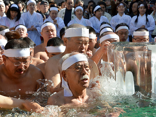 January 9, 2011, Tokyo, Japan - Clad in nothing more than narrow strips of loincloths, Japanese men of all ages, and a few women in thin white robes, brave frigid temperatures perform a ritual of purification at a Shinto shrine in the heart of downtown Tokyo on Sunday, January 9, 2011. Later, the intrepid group of 90 submerged in a pool of near- freezing water in their prayers to the gods for good health and for the safety of their families in the coming year. (Photo by Natsuki Sakai/AFLO) [3615] -mis-