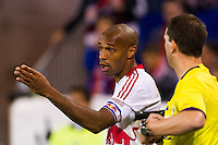 Thierry Henry (14) of the New York Red Bulls talks with the assistant referee. The New York Red Bulls and Sporting Kansas City played to a 0-0 tie during a Major League Soccer (MLS) match at Red Bull Arena in Harrison, NJ, on October 20, 2012.