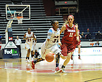 "Ole Miss' Valencia McFarland (3) dribbles vs. Arkansas' Calli Berna (11) at the C.M. ""Tad"" Smith Coliseum in Oxford, Miss. on Thursday, January 12, 2012. Ole Miss won 60-54."