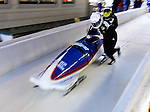 14 December 2006: Isabel Baumann, team pilot of Switzerland 3, pushes her sled at the start of a training run in preparation for the World Cup Bobsleigh Competition at the Olympic Sports Complex on Mount Van Hoevenburg  in Lake Placid, New York, USA.&amp;#xA;&amp;#xA;Mandatory Photo credit: Ed Wolfstein Photo<br />