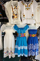 Embroidered huipils and dresses for sale at the Sunday handicrafts market in Merida, Yucatan, Mexico...