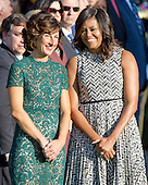 First lady Michelle Obama shares conversation with Mrs. Agnese Landini of Italy during an Official Arrival Ceremony in honor of the visit of Prime Minister Matteo Renzi of Italy on the South Lawn of the the White House in Washington, DC on Tuesday, October 18, 2016. <br /> Credit: Ron Sachs / CNP