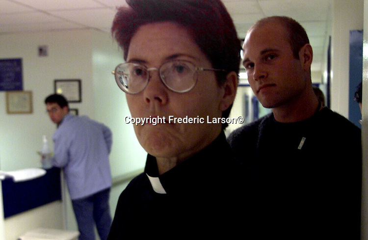 Sister Marilyn and her intern Sean Whitney wait patiently for new incoming injured patients in the emergency room one weekend at San Francisco General Hospital, California.
