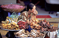 Many types of smoked seafood at outdoor markets. Pentax Spotmatic film camera. 2004