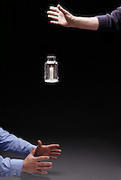 CONVECTION: DROPPING JAR WITH LIT CANDLE (2 of 3)<br /> Convection &amp; Flow of Oxygen Cease  in Freefall<br /> The candle-in-a-bottle is dropped.  In a freely falling frame of reference, objects behave as if there is no net gravity force, thus no &quot;up&quot; for the hot air. The diminishing supply of oxygen causes the flame to dim.
