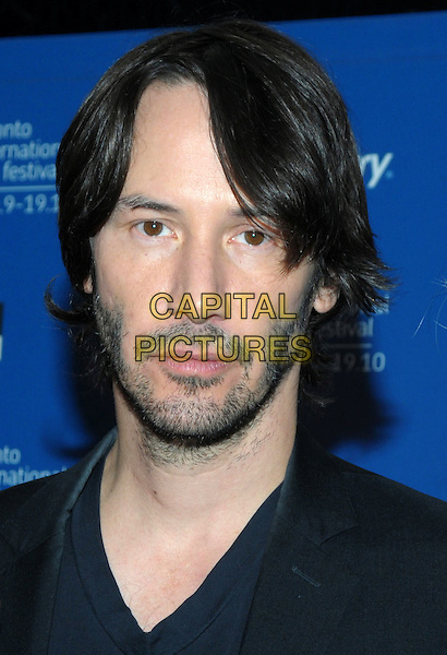 "KEANU REEVES .""Henry's Crime"" Press Conference during the 2010 Toronto International Film Festival held at the Hyatt Regency, Toronto, Ontario, Canada, .14th September 2010..portrait headshot black v-neck t-shirt beard facial hair jacket .CAP/ADM/BPC.©Brent Perniac/AdMedia/Capital Pictures."