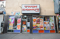 The menu of a Twin Donut Plus cafe is plastered all over the windows in the Fordham Road shopping district in the Bronx in New York on Thursday, January 7, 2016.  (© Richard B. Levine)