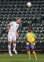 New Zealand's Tony Lochhead beats Solomon Islands' Joses Nawo to the ball in a FIFA World Cup Qualifier Match, North Harbour Stadium, Auckland, New Zealand, Tuesday, September 11, 2012.  Credit:SNPA / David Rowland