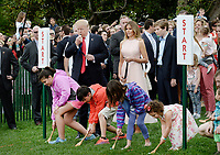 United States President Donald Trump blows a whistle to start an egg roll as First Lady Melania Trump and son Barron look on during the annual Easter Egg Roll on the South Lawn of the White House  in Washington, DC, on April 17, 2017. <br /> CAP/MPI/CNP/RS<br /> &copy;RS/CNP/MPI/Capital Pictures