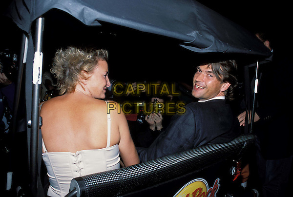 DOUGRAY SCOTT & wife.decide to take a horse and trap back to their hotel after the Terminator premiere only for the driver to refuse to take them to Pall Mall as he wanted to go home himself..www.capitalpictures.com.sales@capitalpictures.com.© Capital Pictures.