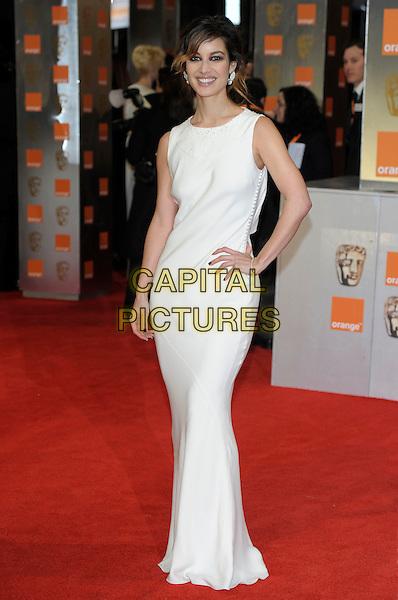 Berenice Marlohe.The Orange British Academy Film Awards ( BAFTA ), Royal Opera House, Bow St., London, England..February 12th, 2012.baftas full length dress hand on hip white .CAP/PL.©Phil Loftus/Capital Pictures.