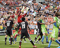 Julius James #2 of D.C. United holds Patrick Ianni #4 of Seattle Sounders FC as Troy Perkins #23 goes up for the ball during an MLS match at RFK Stadium on July 15 2010, in Washington DC.Seattle won 1-0.