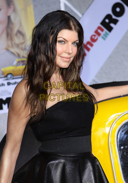 "FERGIE (STACY FERGUSON).Attending the Los Angeles Premiere of ""When In Rome"" held at The El Capitan Theater, Hollywood, CA, USA, .27th January 2010..arrivals half length leather peplum dress strapless black .CAP/ADM/TC.©T. Conrad/AdMedia/Capital Pictures."